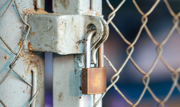 A lock on a chain-link fence