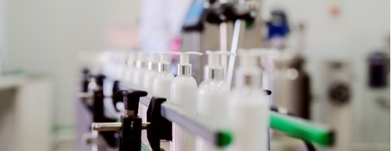 Picture of lotion bottles on a production line