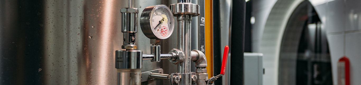 Pressure gauge and valve connected with steel tank